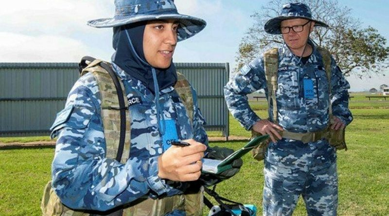 Flying Officer Ayah Khalid, left, with Leadership Reaction Course team member Flying Officer Clayton Wilson during a course at Officer Training School at RAAF Base East Sale. Story by Flight Lieutenant Julia Ravell. Photo by Flight Sergeant Scott Robbins.