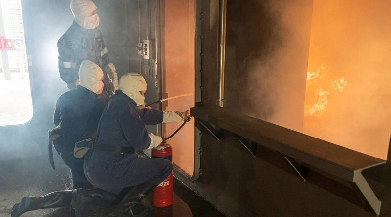 Participants in the Defence Work Experience Program are instructed how to use fire extinguishers in the School of Ship Safety and Survivability fire simulator during a visit to HMAS Cerberus. Story by Alex DeValentin. Photo by Leading Seaman James McDougall.