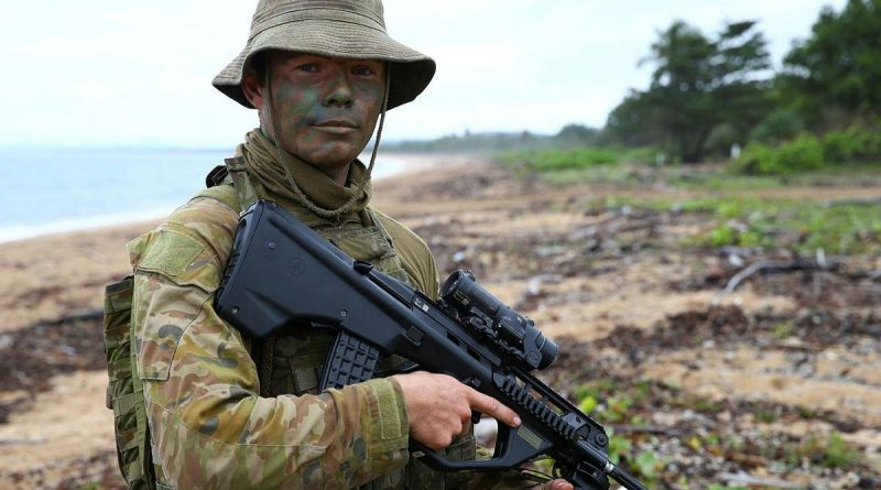 Australian Army soldier and cargo specialist Private Harry Ramsay stands at Cowley Beach, Queensland, during Exercise Sea Explorer. Story and photo by Warrant Officer Class 2 Max Bree.