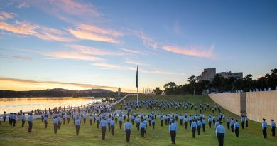 Australian Defence Force Academy Air Force trainee officers stand at attention during the raising of the RAAF Ensign at Commonwealth Place on 31 March 2021. Photo by Lannon Harley.
