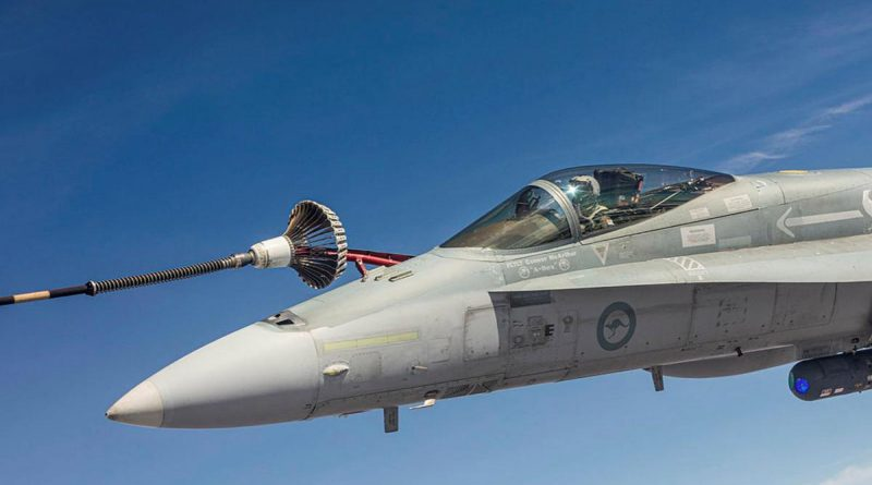F/A-18A Hornet A21-008 refuels in the air over the Northern Territory during Exercise Arnhem Thunder. Story by Flight Lieutenant Robert Cochran. Photo by Leading Aircraftman Stewart Gould.