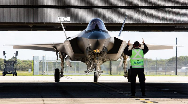A pilot is marshalled in after completing his first flight in an F-35A Lightning II during the Operational Conversion course at RAAF Base Williamtown. Photo by Sergeant Guy Young.
