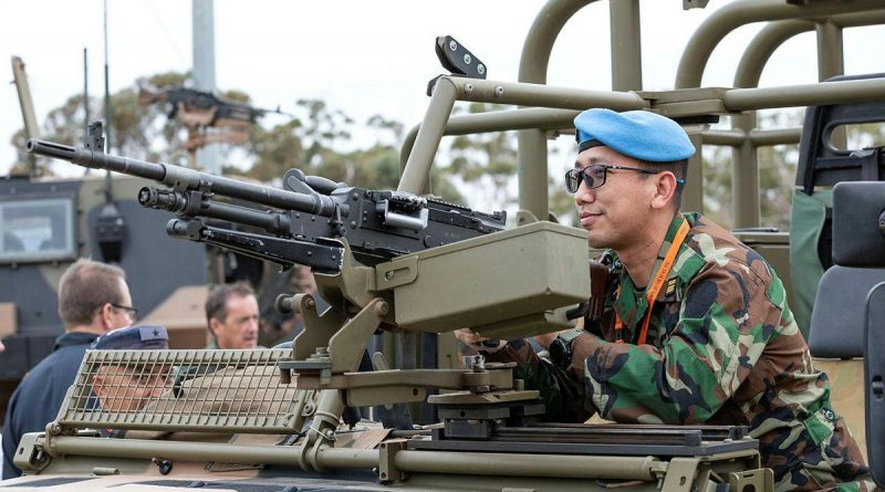 Defense Attaché to the Royal Embassy of Cambodia, Colonel Khanrithy Morn from the Royal Cambodian Army, inspects the weapon system mounted to a No. 3 Security Forces Squadron vehicle at RAAF Base Edinburgh. Story by Lieutenant Gordon Carr-Gregg. Photo by Leading Aircraftman Sam Price.