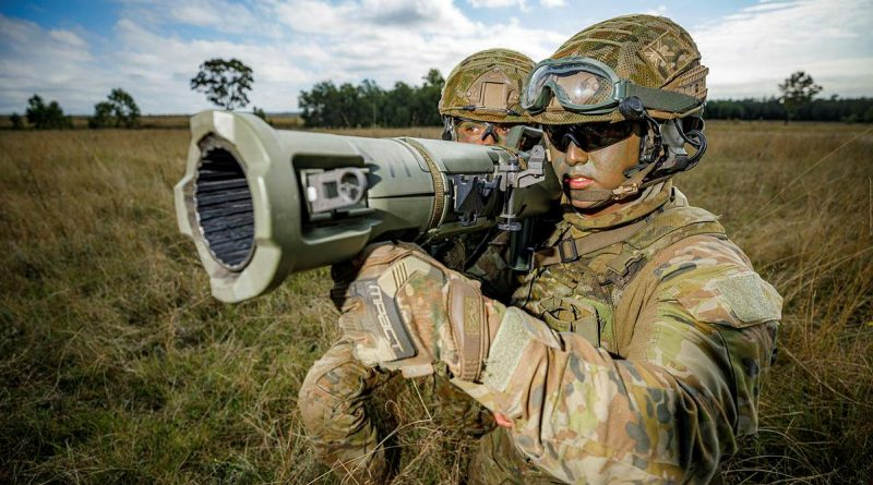 Airfield defence guards Leading Aircraftman Jarryd May, right, and Leading Aircraftwoman Tekaisha Davies from No. 1 Security Forces Squadron prepare to fire the 84mm Carl Gustav at the Singleton Military Training Area. Story by Squadron Leader Bettina Mears. Photo by Corporal Craig Barrett.