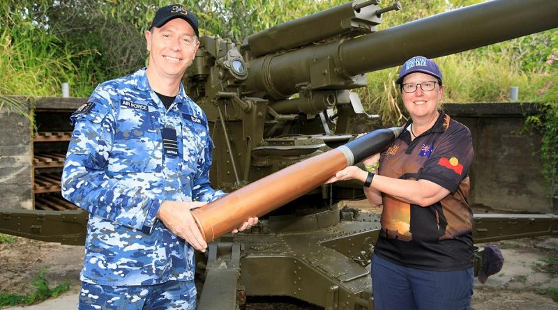 Commanding Officer No. 35 Squadron Wing Commander Scott Egan presents the curator of the Torres Strait Heritage Museum, Vanessa Seekee, with a replica 3.7-inch shell. Story by Flying Officer Robert Hodgson. Photo by Corporal Brett Sherriff.