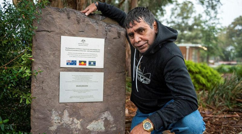 Elder Uncle Ringo Terrick, of the Wurundjeri people, next to the Acknowledgement of Country plaque at Simpson Barracks, Melbourne. Story by Captain Kristen Cleland. Photo by Private Michael Currie.