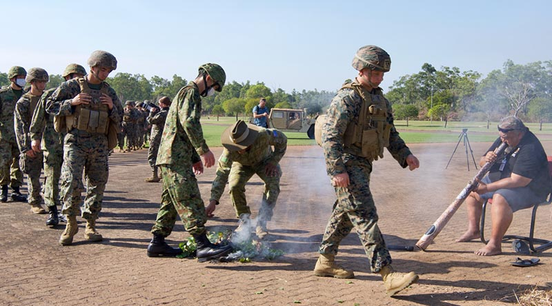 Australian and Japanese soldiers and US Marines participate in a smoking ceremony Robertson Barracks to kick-start Exercise Southern Jackaroo.Photo by Barrie Collins, for CONTACT.