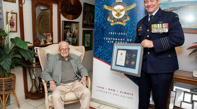 Senior ADF Officer RAAF Base Amberley Group Captain Iain Carty presents Air Force veteran Kevin Statham with an Air Force 2021 commemorative memento. Story by Evita Ryan. Photo by Leading Aircraftwoman Emma Schwenke.