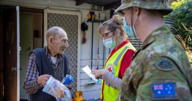 Mount Dandenong resident Jim Henderson has a welfare check by Australian Red Cross representative Kerry Macfarlane and Corporal Paul Summerbell after the recent storm. Story by Captain Martin Hadley. Photo by Corporal David Cotton.