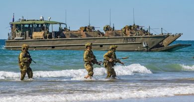 Australian Army soldiers, of 2nd Batallion, the Royal Australian Regiment, approach Langham Beach, Queensland, during Talisman Sabre 2019. Story by Major Cameron Jamieson. Photo by Sergeant 1st Class Whitney C. Houston.