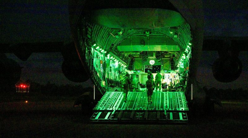 An Air Force aircraft security operations team on the ramp of a C-17A Globemaster III at RAAF Base Amberley during Exercise Precision Gauntlet. Story by Flight Lieutenant Suellen Heath. Photo by Corporal Brett Sherriff.