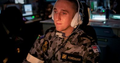 Leading Seaman Combat Systems Operator Joshua Fordham operates an aircraft control console in the Operations Room of HMAS Ballarat during the ship's Regional Presence Deployment. Story by Lieutenant Gary McHugh. Photo by Leading Seaman Ernesto Sanchez.