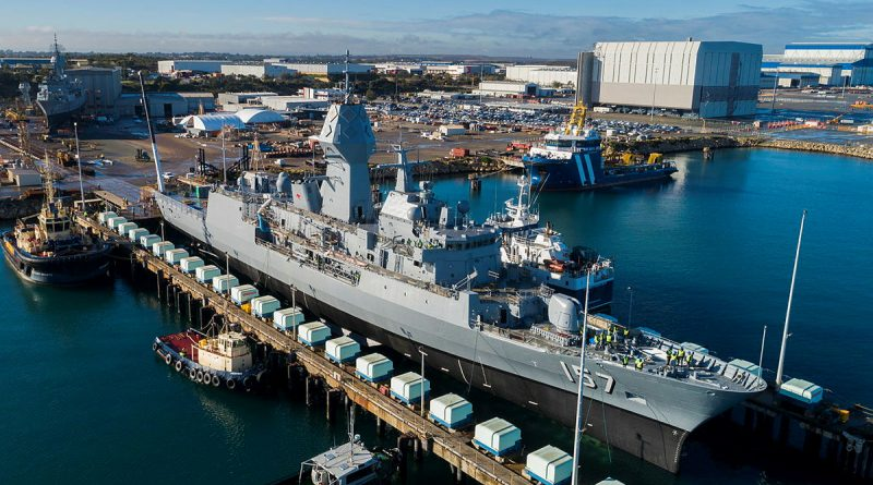 HMAS Perth is lowered out of the dry dock at the Australian Marine Complex at Henderson, WA, after completion of a major part of the Anzac Midlife Capability Assurance Program upgrades. Story by Harriet Pointon Mather.