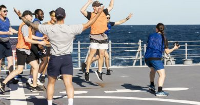 Seaman Boatswain's Mate Melita Tennant prepares to throw the ball during a Bin Ball competition held on-board HMAS Brisbane, off the coast of Queensland for Exercise Talisman Sabre 2021. Story by Lieutenant Sarah Rohweder. Photo by Leading Seaman Daniel Goodman.