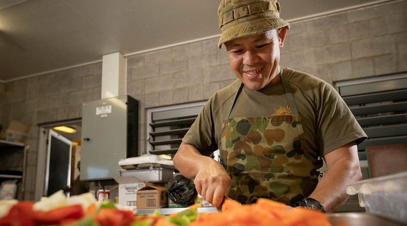 Private Supachai Kladpin, of the 10th Force Support Battalion, cooks meals in the Camp Growl kitchen in the Shoalwater Bay Training Area, Queensland, during Exercise Talisman Sabre. Story by Lieutenant Max Logan. Photo by Corporal Madhur Chitnis.