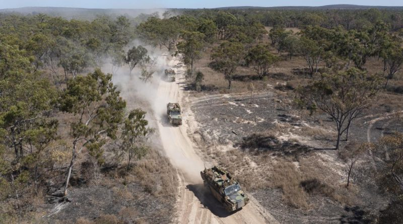Australian Army Bushmaster's from Battlegroup Coral, conduct a forward passage of lines at the Townsville Field Training Area in Queensland, during Exercise Talisman Sabre 2021. Story by Captain Diana Jennings. Photo by Corporal Brandon Grey.