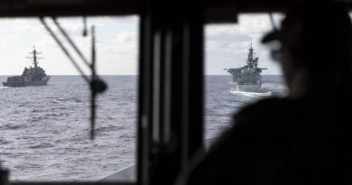 HMAS Brisbane's Navigating Officer, Lieutenant Marita Knack, looks on as the ship sails astern of (L to R) USS Rafael Peralta, USS America and HMCS Calgary off the coast of QLD, during Exercise Talisman Sabre 2021. Story by Lieutenant Sarah Rohweder. Photo by Leading Seaman Daniel Goodman.