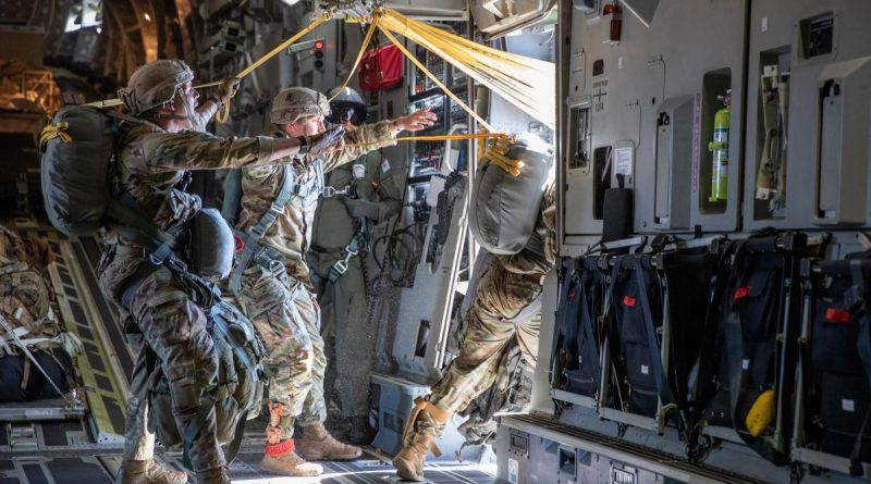 """Alaskan based US Army paratroopers from 3rd Battalion, 509th Parachute Infantry Regiment, 4th Infantry Brigade Combat Team (Airbone), 25th Infantry Division """"Spartan Brigade"""", paradrop from a RAAF C-17A on Talisman Sabre 21. Story by Flight Lieutenant Chloe Stevenson. Photo by LACW Emma Schwenke."""
