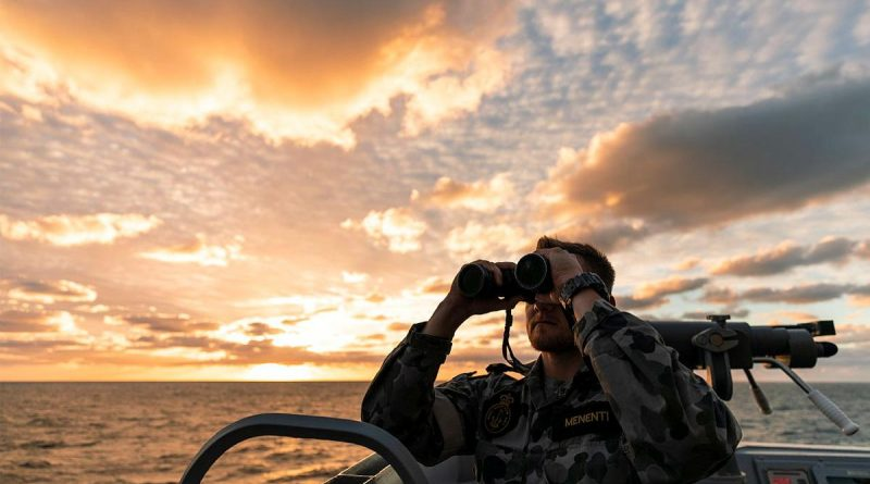 Officer of the watch Sub-Lieutenant Lucas Menenti looks out from HMAS Brisbane's bridge wing during an air-warfare serial off the coast of Queensland on Exercise Talisman Sabre. Story by Lieutenant Sarah Rohwede. Photo by Leading Seaman Daniel Goodman.