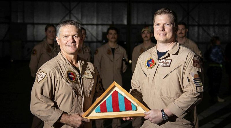 The Commander's Pennant for Air Task Group 630 is passed from outgoing commander Wing Commander Ric Peapell, left, to the incoming commander Wing Commander Alexander Cave. Photo by Glen McCarthy.