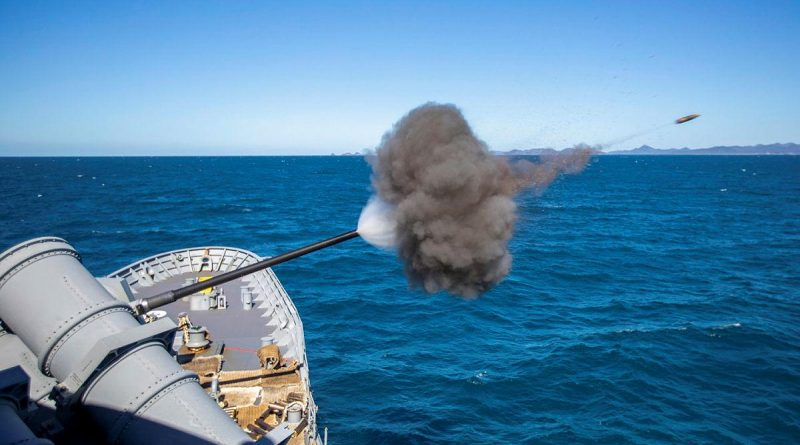 HMAS Ballarat conducts a five-inch gun firing while sailing off the coast of Queensland during Exercise Talisman Sabre. Story by Lieutenant Commander Ryan Zerbe. Photo by Leading Seaman Ernesto Sanchez.