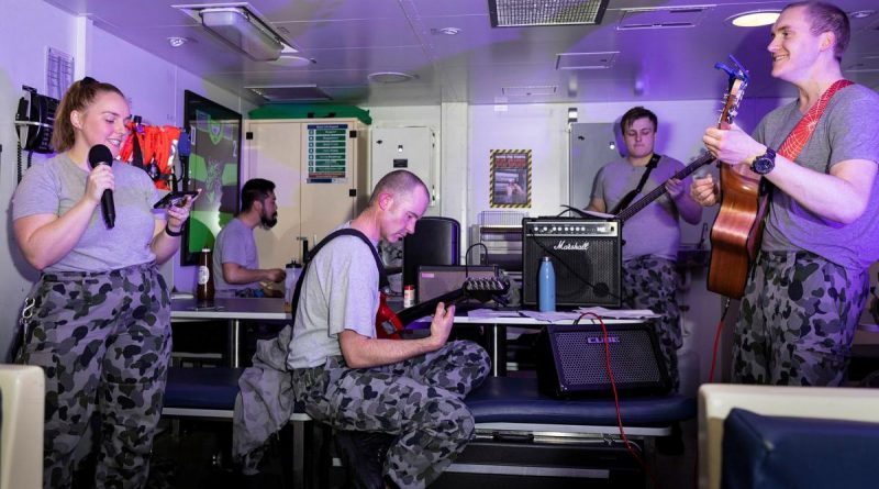 HMAS Brisbane's band, made up of members of the crew, play their first gig together in front of a live audience in the junior sailors' café off the coast of Queensland during Exercise Talisman Sabre. Story and photo by Leading Seaman Daniel Goodman.