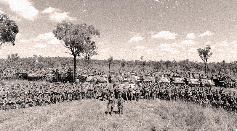 Group photo of troops involved in a complex assault during combined-arms training near Townsville, including 3rd Brigade, 11th Brigade, Royal Yeomanry and Queens Dragoon Guards. Photo by Major Al Green, digitally altered by CONTACT.