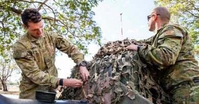 Private Samuel Bennett, left, and Private Jesse Stroud, from the 1st Battalion, Royal Australian Regiment, prepare equipment at Lavarack Barracks, Townsville, prior to deploying on Exercise Talisman Sabre 2021. Story by Flight Lieutenant Chloe Stevenson. Photo by Leading Aircraftwoman Emma Schwenke.