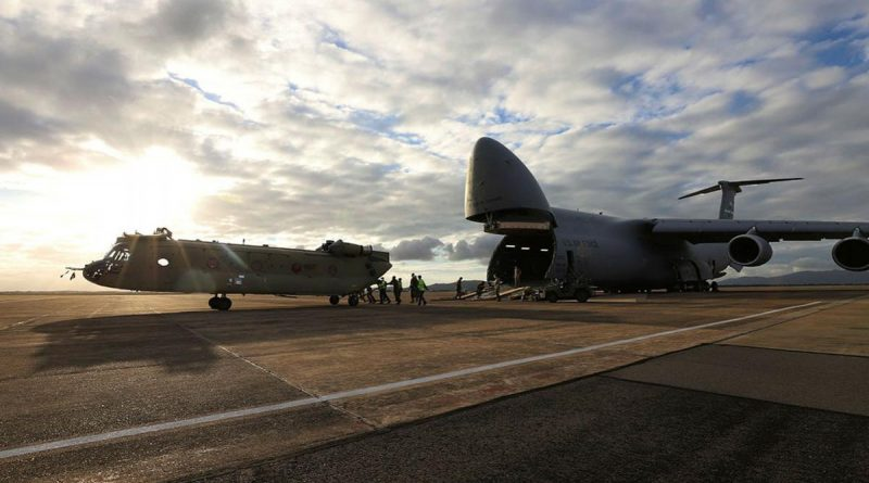 A new CH-47F Chinook heavy-lift helicopter is unloaded from a United Stated C-5 Galaxy at RAAF Base Townsville, Queensland. Photo by Trooper Lisa Sherman.