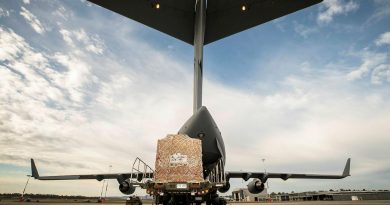 Humanitarian aid equipment is loaded into a No. 36 Squadron C-17A Globemaster III aircraft bound for Fiji. Story by Lieutenant Gordon Carr-Gregg. Photo by Sergeant Ben Dempster.