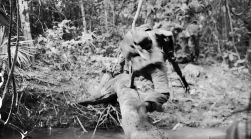 One of thousands of photos taken by Billy Cunneen in Vietnam –a 6RAR soldier dives for cover as firing breaks out during Operation Ingham.