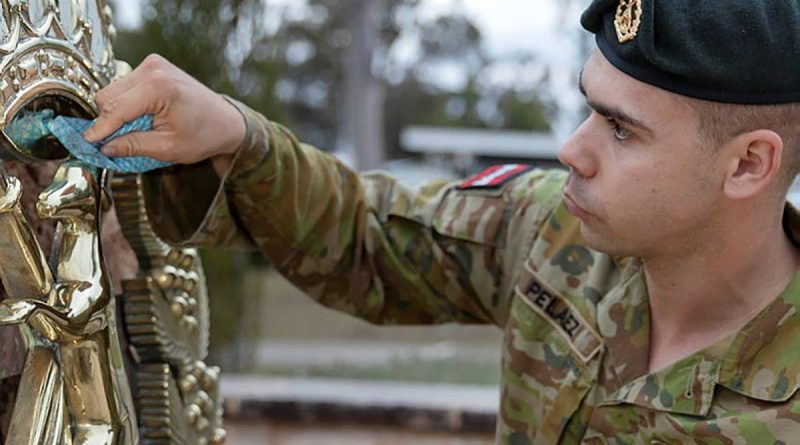 Corporal David-Jose Pelaez, a section commander from the School of Infantry, cleans the Skippy Badge at Depot Company headquarters, Singleton. Story and photo by Private Jacob Joseph.
