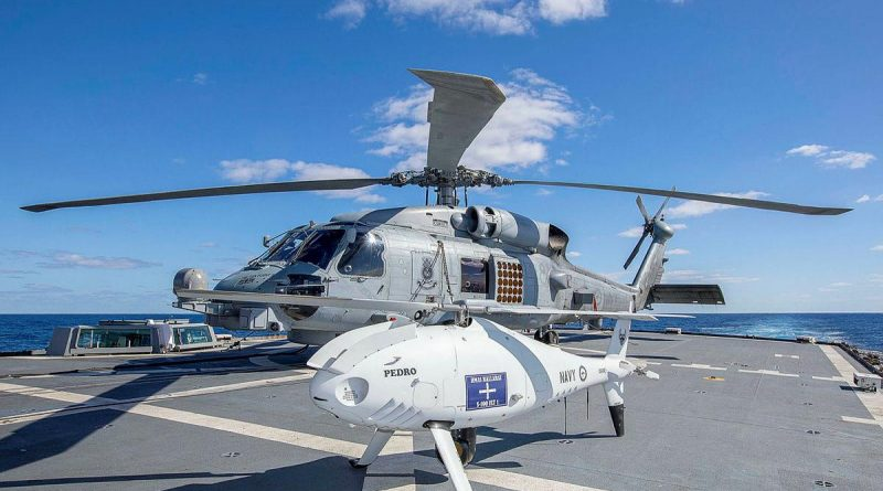HMAS Ballarat's embarked MH-60R and S-100 Schiebel Camcopter on the flight deck during Exercise Talisman Sabre. Story by Lieutenant Commander Ryan Zerbe. Photo by Leading Seaman Ernesto Sanchez.