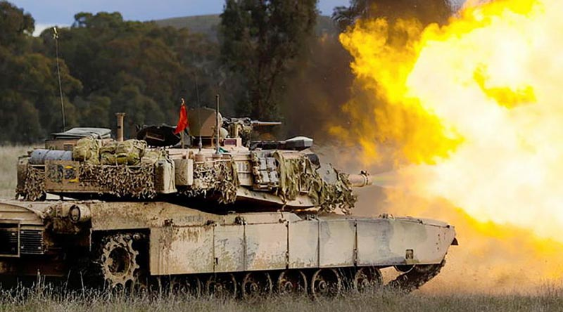 An Australian Army M1A1 Abrams main battle tank fires its main armament during live-fire training for Exercise Gauntlet Strike at Puckapunyal Military Training Area. Photo by Corporal Robert Whitmore.