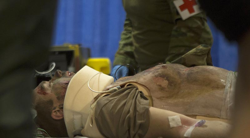 Australian Army medics with the 2nd General Health Battalion, stationed at Gallipoli Barracks in Enoggera, Queensland, simulate injury assessment and resuscitation procedures on a mass casualty exercise during Exercise Talisman Sabre 2019 at Williamson Airfield, Shoalwater. Photo by US Marine Corps Lance Corporal Kealii De Los Santos.
