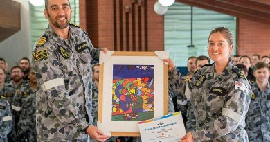 Commanding Officer NUSHIP Stalwart Commander Steve McCraken presents Leading Seaman Medic Abbey-Rose Yeomans with her award and artwork at HMAS Stirling in Rockingham. Story by Dallas McMaugh. Photo by Able Seaman Luke Miller.