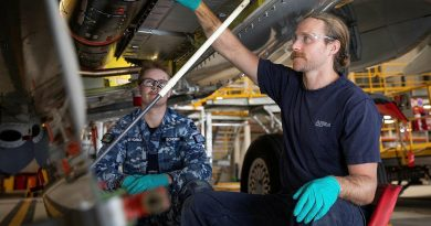 Aircraft fitter Aircraftman Blake Schober, from No.11 Squadron, left, and Airbus maintenance team member Daiman Gordon inspect the fuselage of a P-8A Poseidon at RAAF Base Edinburgh. Story by Bettina Mears. Photo by Leading Aircraftman Sam Price.