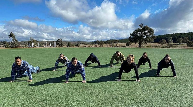 Headquarters Joint Operations Command and Spotless personnel participate in the 2021 Push For Better push-up challenge on the Walter Roy Hyles Field at HQJOC Bungendore, NSW. Story by Sarah Collins.