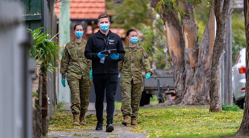 Army Privates Kate Larby and Maddison Lillie, and Victorian Department of Health Authorised Officer Daniel Green on patrol as part of a COVID-19 Household Engagement Program to support the Victorian State government's response to the COVID-19 Pandemic. Photo by Private Michael Currie.