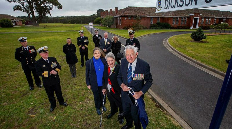 Commodore Jim Dickson (retd) unveils the sign for the new road named in his honour at HMAS Cerberus, joined by members of his family and senior Cerberus personnel. Story by Lieutenant Commander Helen Ward. Photo by Petty Officer James Whittle.