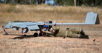 Lieutenant Dallin Stirling attaches post-flight safety tags to a Shadow 200 during Exercise Dragon Sprint at the Townsville Field Training Area. Story and photo by Petty Office Lee-Anne Cooper.