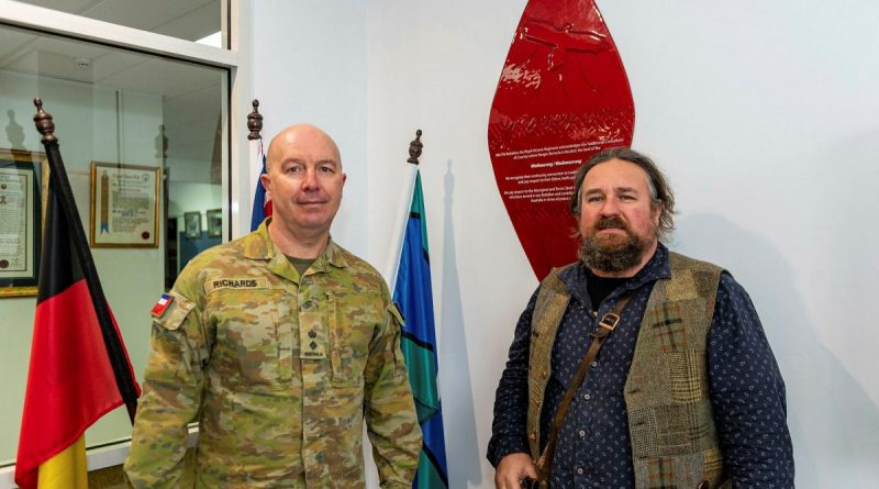 Commander of the 8th/7th Battalion, Royal Victoria Regiment, Lieutenant Colonel Shaun Richards shows Wathaurong man Barry Gilson the Wathaurong Glass shield at the battalion's headquarters. Story by Captain Kristen Daisy Cleland. Photo by Private Michael Currie.