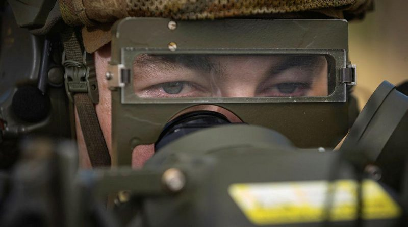 Gunner Nathan Wood, of the 16th Regiment, Royal Australian Artillery, observes a target during the RBS 70 man-portable air defence missile system training serial at the Shoalwater Bay Training Area. Story by Petty Officer Jake Badior. Photo by Corporal Madhur Chitnis.