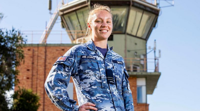 Air traffic controller Flight Lieutenant Amy Tinto, from No. 452 Squadron, in front of the air traffic control tower at RAAF Base Townsville during Exercise Talisman Sabre 2021. Story by Flight Lieutenant Chloe Stevenson. Photo by Leading Aircraftwoman Emma Schwenke.
