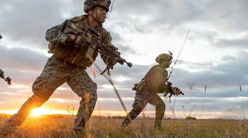 US Marines from 1st Battalion, 7th Marines, moves forward during an assault on Bowen Airport in Queensland on Exercise Talisman Sabre. Story by 1st Lt. Jon Carkhuff (US). Photo by Leading Aircraftwoman Jacqueline Forrester.