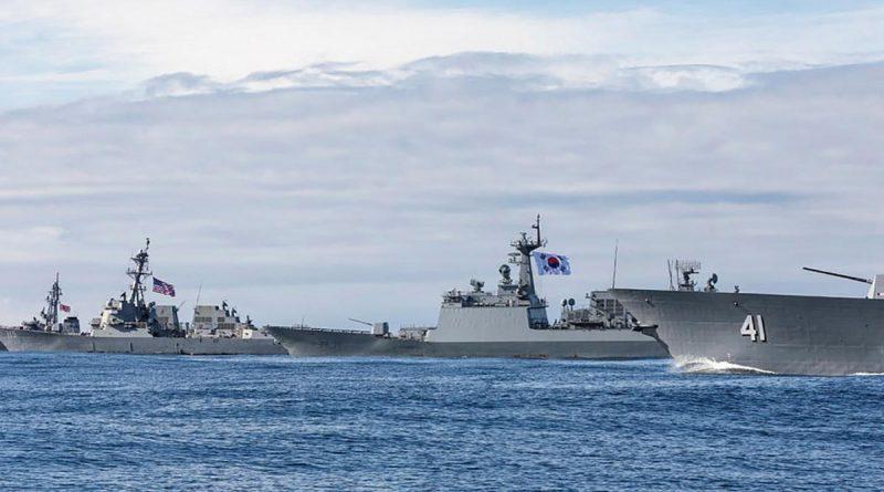 HMAS Brisbane, JS Makinami, ROKS Wang Geon and USS Rafael Peralta sail in company during Exercise Pacific Vanguard. Story by Lieutenant Geoff Long. Photo by Leading Seaman Daniel Goodman.