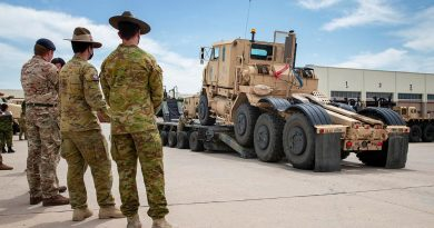 Soldiers from the US Army's 14th Sustainment Brigade demonstrate their vehicle-recovery capabilities to soldiers from the Australian, British and Canadian armies during the Joint Warfighting Assessment. Story by Captain Taylor Lynch. Photo by Corporal Nicole Dorrett.