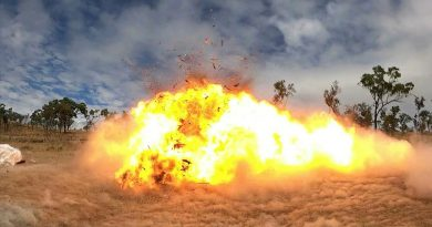 Setting off the charge, a wooden pallet explodes during demolition training on Exercise Phoenix Strike, held in Townsville, Queensland. Story by Captain Lily Charles. Photo by Corporal Brodie Cross.