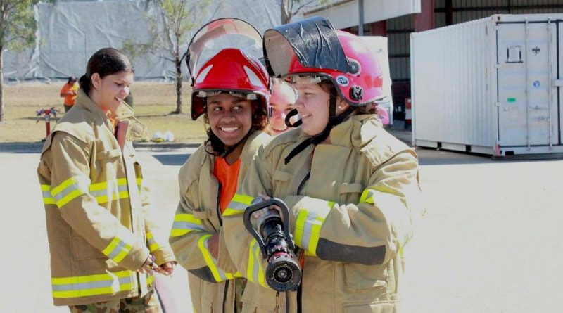 Khalia, Anne and Brieanna, from Stars Foundation, participate in a mock firefighting drill with 9 Petroleum Platoon, Lavarack Barracks as part of a Defence Work Experience Day. Story by Captain Annie Richardson. Photo by Corporal Ashely Hetherington.