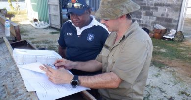 SIG Wayne Tranter provides a site brief to Papua New Guinea Navy Able Seaman Basil as part of the Communications Infrastructure Upgrade on Manus Island. Story by Leading Seaman Kylie Jagiello.